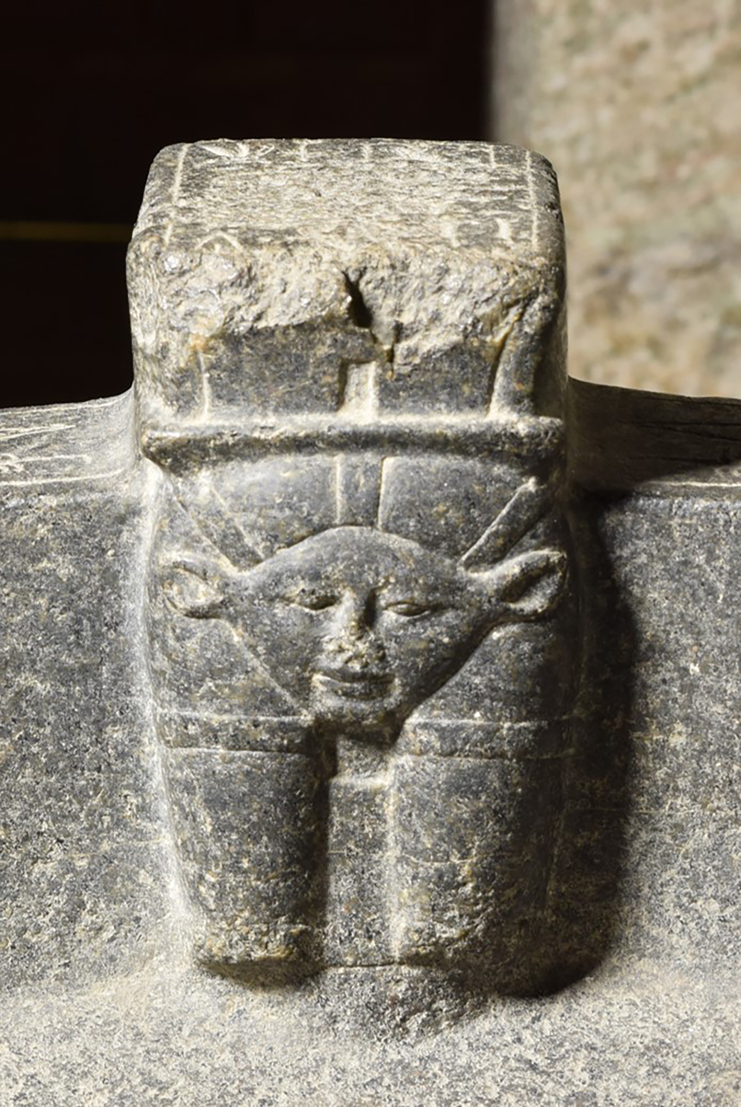 Figure 18: The interior of the basin has a Hathor head protome. Lady Ruiu is positioned directly opposite this image.