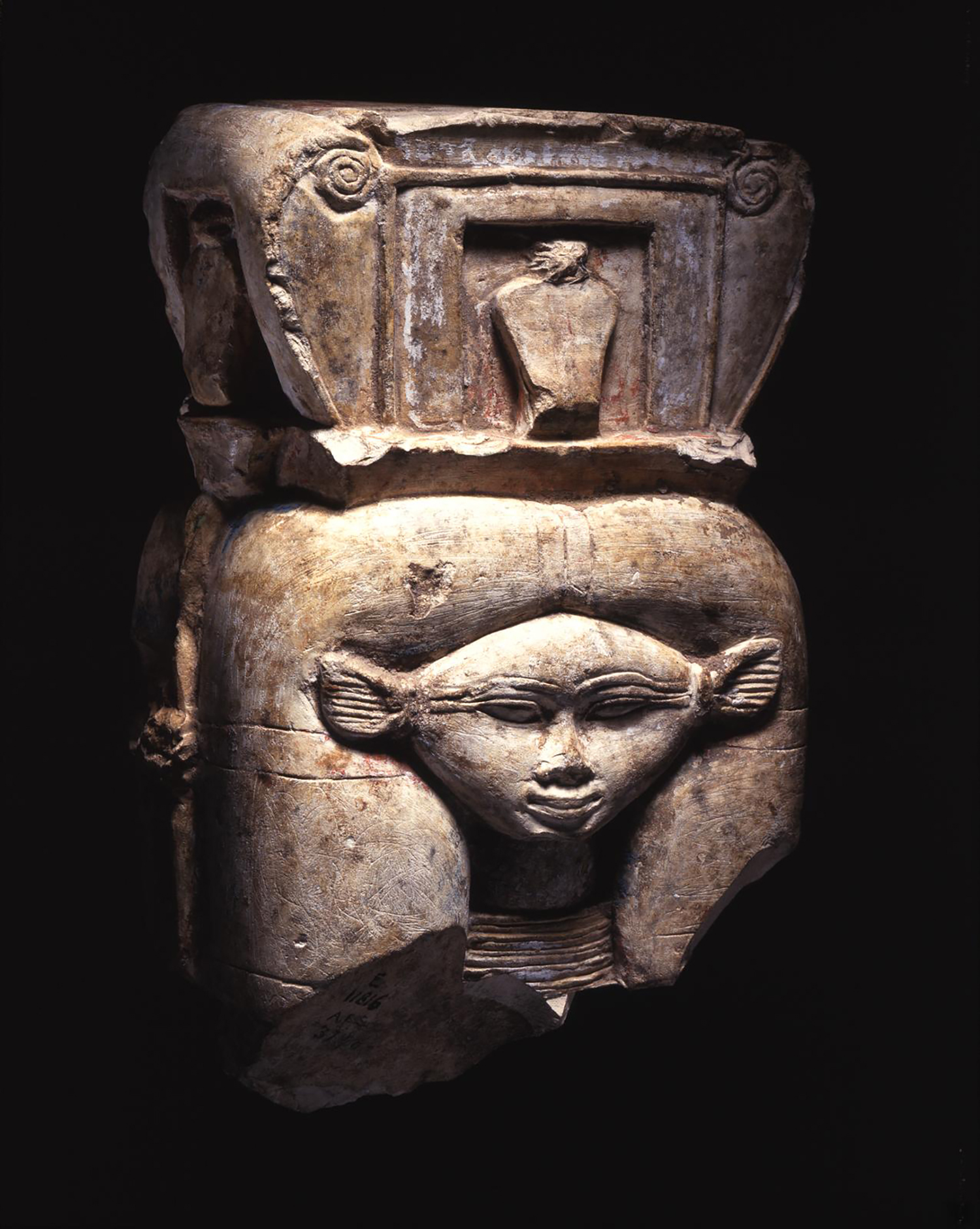 Figure 20: While Hathor could appear in fully human, or fully bovine form, a common representation of the goddess combines both forms. The Hathor head image can be seen on this fragmentary statue; Hathor is shown with cow ears and a triangularly shaped face. Photo courtesy of the University of Pennsylvania Museum of Archaeology and Anthropology [UPMAA E11816].