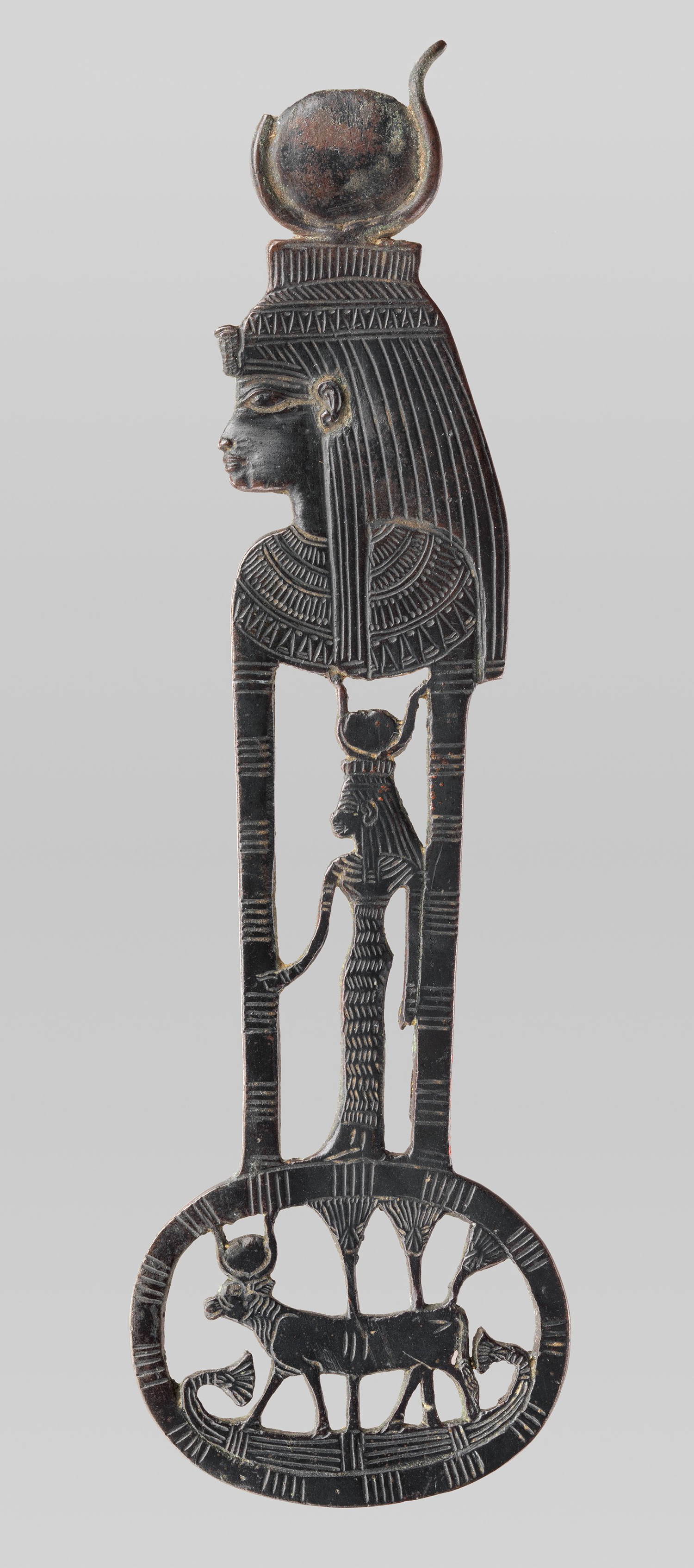 Figure 22: This  menat , or necklace counterpoise, depicts the goddess Hathor both in the form of a woman wearing a horned sundisk crown and as a cow wearing a similar headgear. Image courtesy of the Metropolitan Museum of Art [51.157.2, Rogers Fund, 1951].