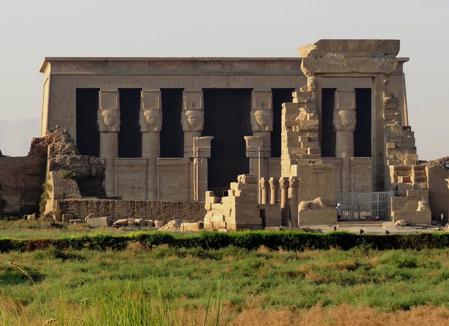 Figure 23: The temple of Hathor at the site of Dendereh was the goddess's main cult center. The columns in this temple have capitals in the shape of Hathor heads. Photo courtesy of Olaf Tausch.