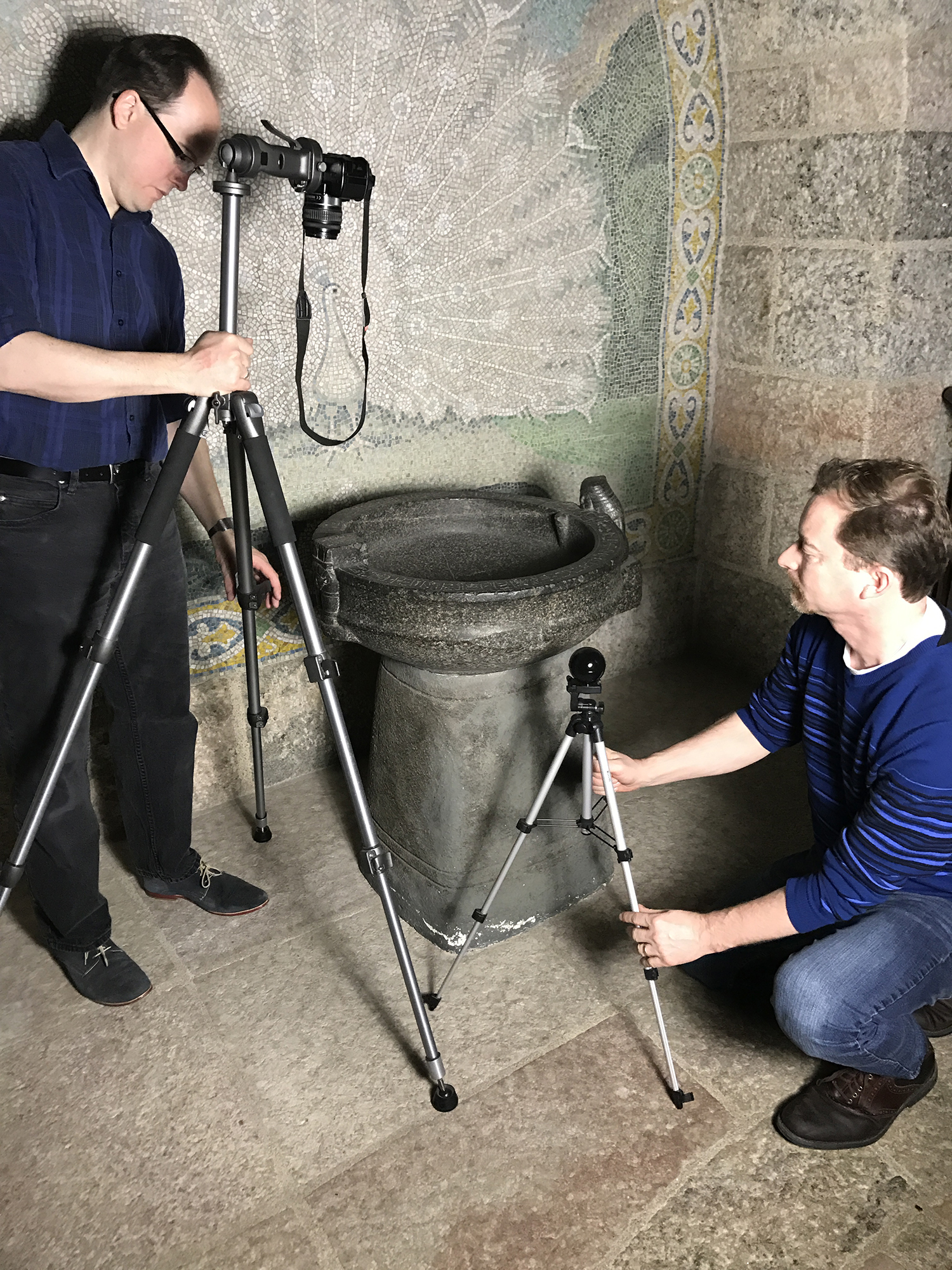 Figure 26: Egyptologists Dr. Kevin Cahail (left) and Dr. Josef Wegner of the Penn Museum carry out RTI photography on the basin to see if areas of the inscriptions that have damage can be made clearer by modifying the light.