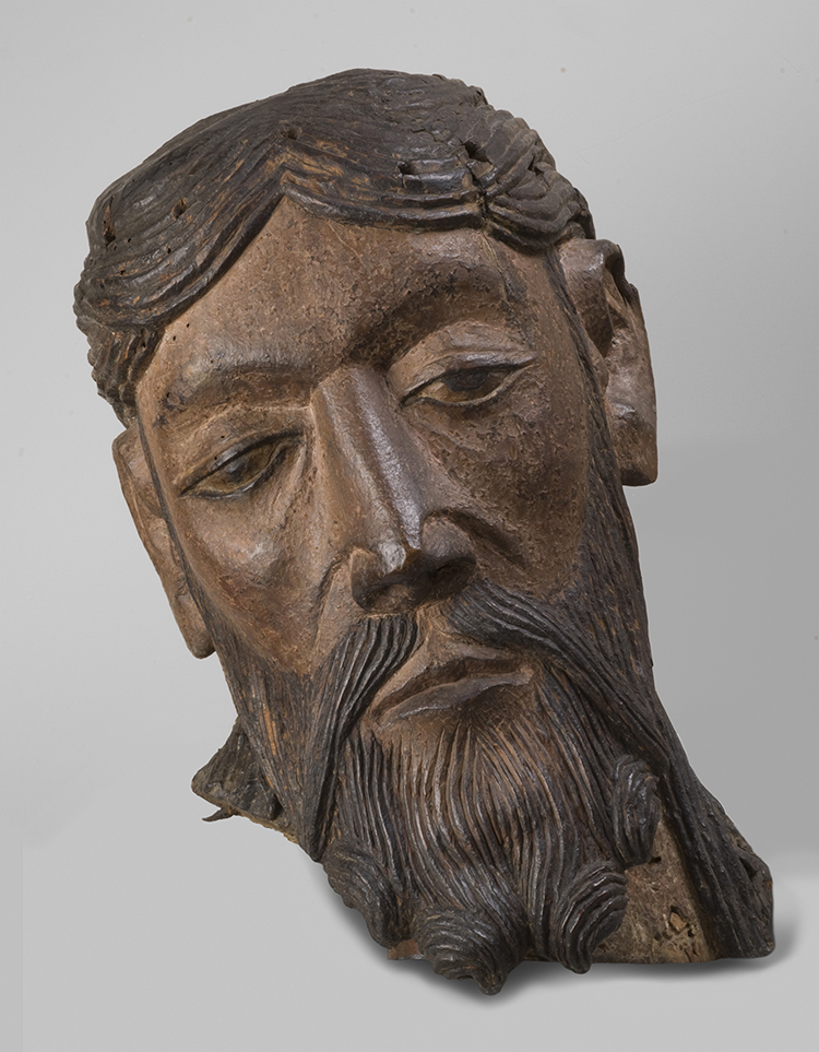 Figure 19: Head from a Figure of the Crucified Christ, possibly made in central France, 1150-1200, wood with polychromy, 18 7/8 x 7 1/16 in., Philadelphia Museum of Art: Gift of Raymond Pitcairn, 1965-216-2.