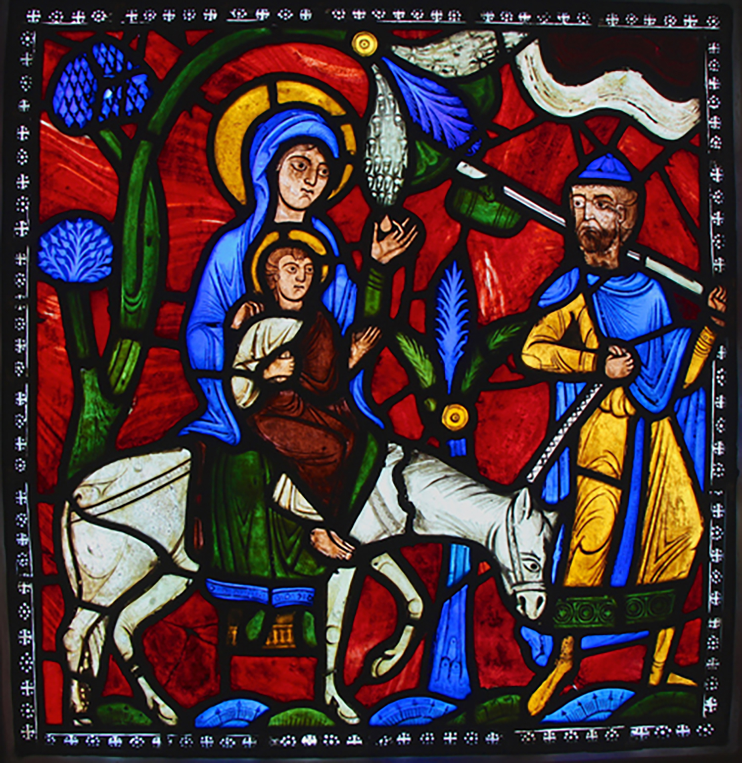 Figure 8: The Flight into Egypt, from the Infancy of Christ window of the Abbey Church of Saint-Denis, France, c. 1140-1145 (Glencairn Museum, 03.SG.114). This panel in Glencairn's stained glass collection demonstrates the unique qualities of the medieval striated ruby color.