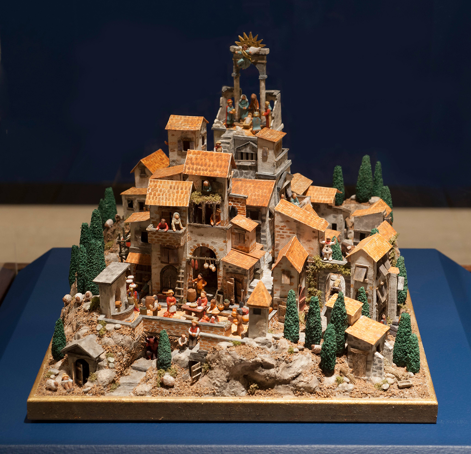 Figure 3: Piccolo Presepe  (Italian for small Nativity scene), made by R. Michael Palan, is set within Roman ruins at the top of an Italian village. The scene includes more than sixty tiny figures. Photo by R. Michael Palan.