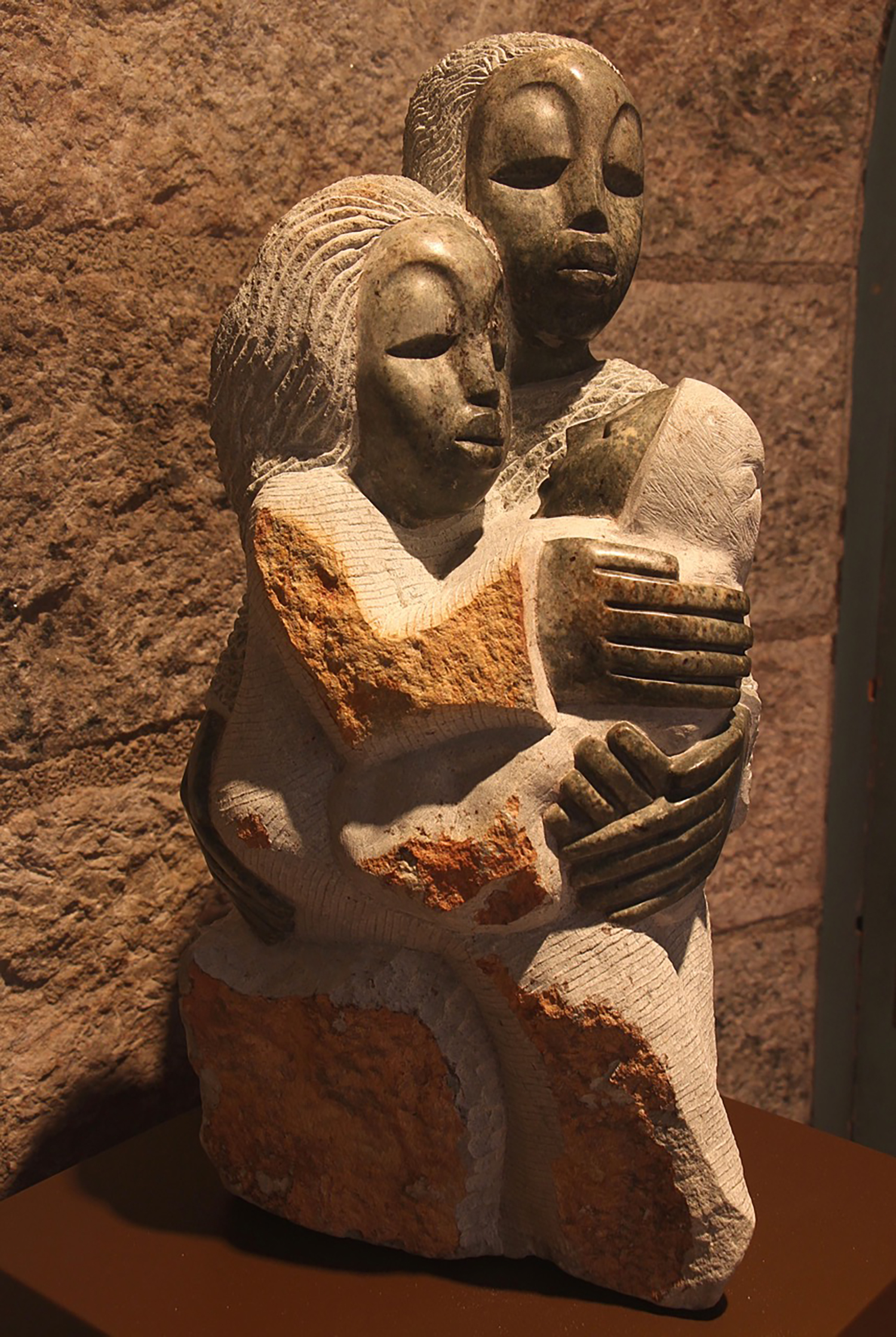 """Figure 5: This representation of the Holy Family was carved by Vernon Nyagweta, a sculptor from Zimbabwe. The stone is a form of serpentine called """"springstone."""" The outer layer is a rich reddish brown, while the interior is a deep greenish color. The faces and hands are waxed and polished, giving the piece a tri-color effect. On loan from the Knights of Columbus Museum, New Haven, Connecticut."""