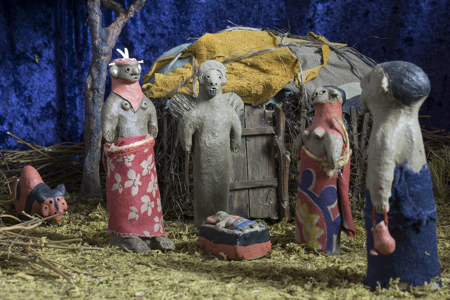 Figure 6:This Nativity was made in Kenya by a member of the Samburu tribe from mud, dung, paint, and cloth. The Samburu are a semi-nomadic ethnic group inhabiting northern Kenya. They share a common language with the Maasai and wear the same form of dress—brightly colored shukas. The figures in this Nativity are dressed in traditional shukas. The Samburu believe in one supreme god, Nkai. Today some Samburu have adopted Christianity. On loan from the Knights of Columbus Museum, New Haven, Connecticut.