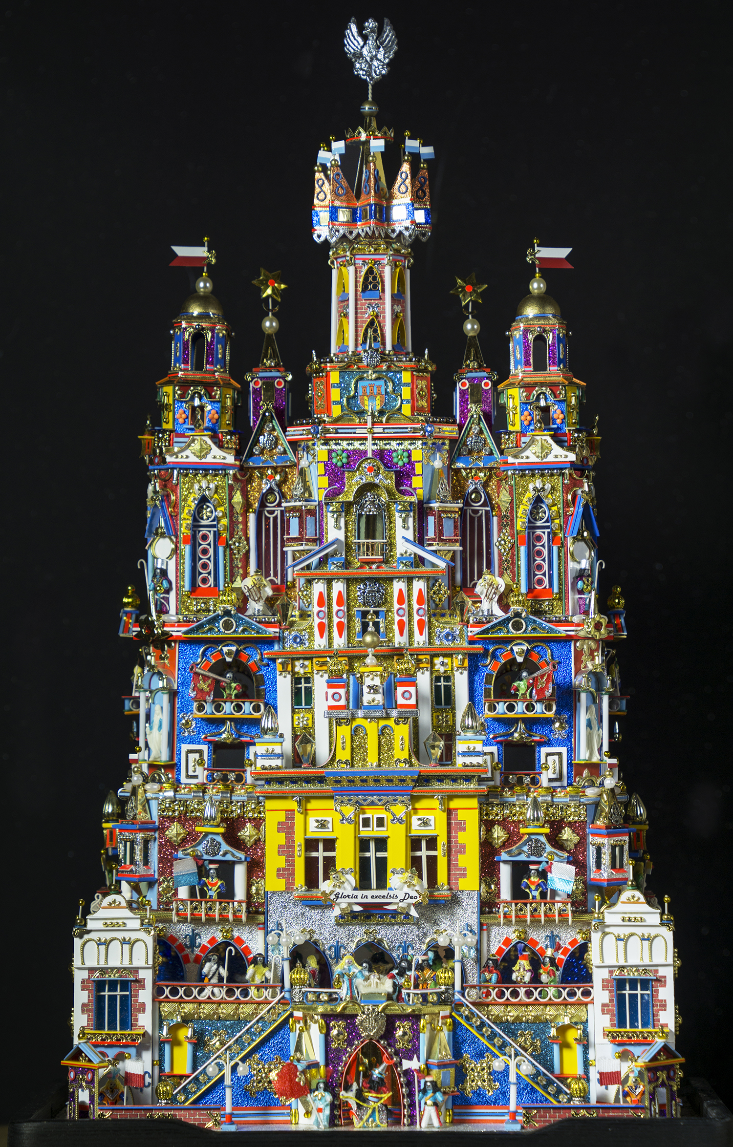 Figure 14:This Nativity, known as a szopka, was made in Poland by Kazimierz Stopinski. The unique folk tradition of the szopka dates to the late 18th and early 19th centuries, with the portable theaters made for Nativity puppet plays. It takes the form of an elaborate building facade in which the tiny figures of the Holy Family are surrounded with fanciful architectural features similar to those seen on Krakow's historic buildings. Every year since 1937 a szopka-building competition has been held in Krakow's market square. Stopinski has won first prize three times for his entries (medium and small category), most recently in 2015. On loan from the Knights of Columbus Museum, New Haven, Connecticut.