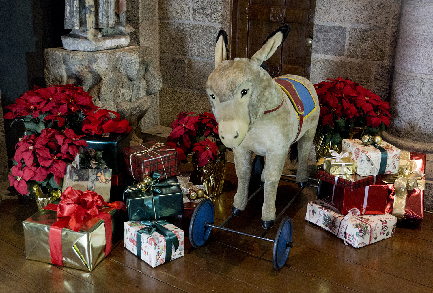 """Figure 20:One of the new additions to the """"Christmas in the Castle"""" tour this year is a large, ride-on Steiff donkey, donated back to Glencairn by members of the Pitcairn family. When the Pitcairns lived at Glencairn it was placed each year beneath the Christmas tree."""