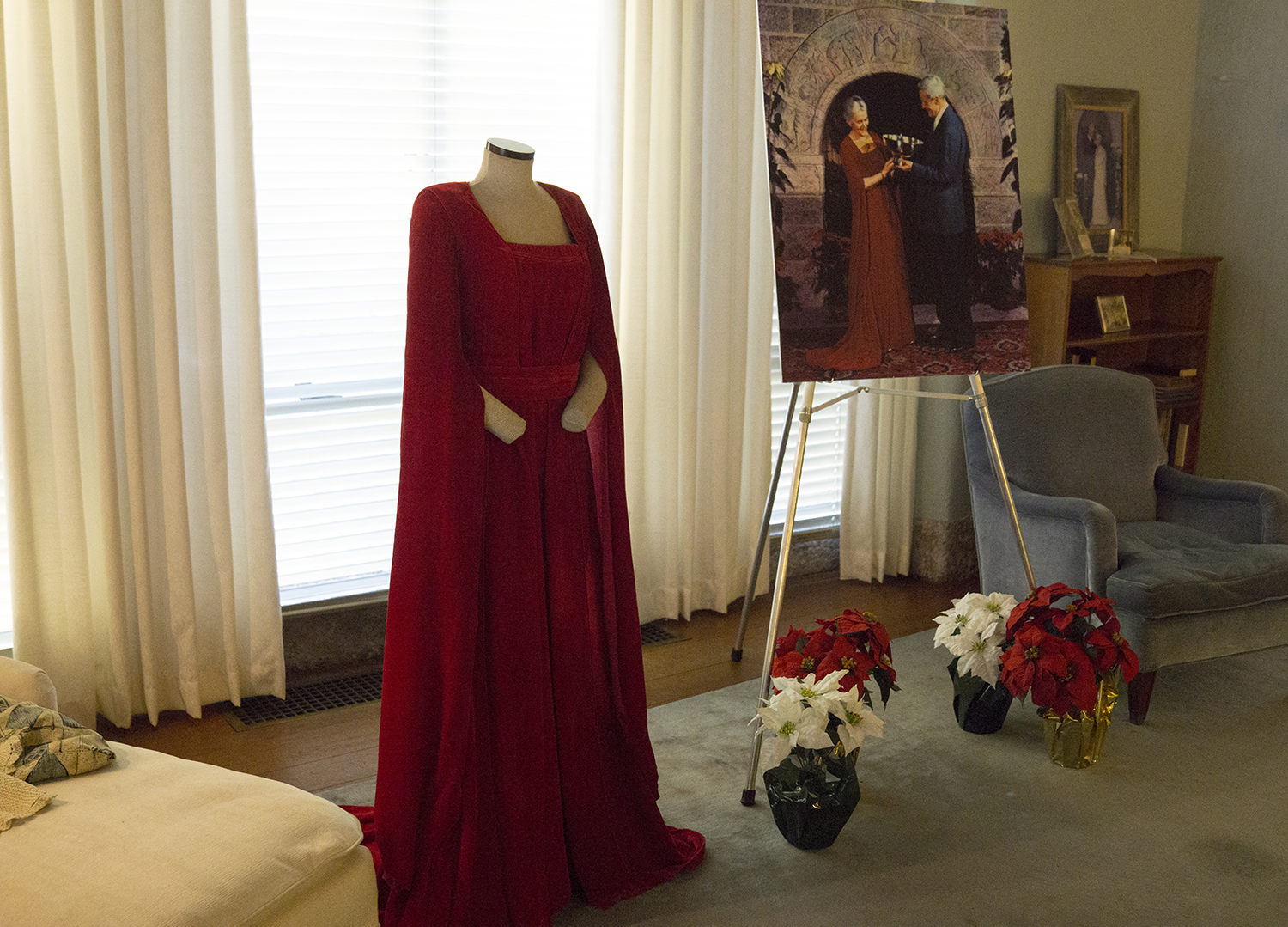 """Figure 21:The """"Christmas in the Castle"""" tour includes Mildred Pitcairn's Christmas gown, which she wore annually at the Glencairn Christmas Sing over a period of many years. It was made from red velvet, and was probably designed for Mildred by her husband Raymond. Raymond designed a number of gowns for Mildred during their 55-year marriage."""