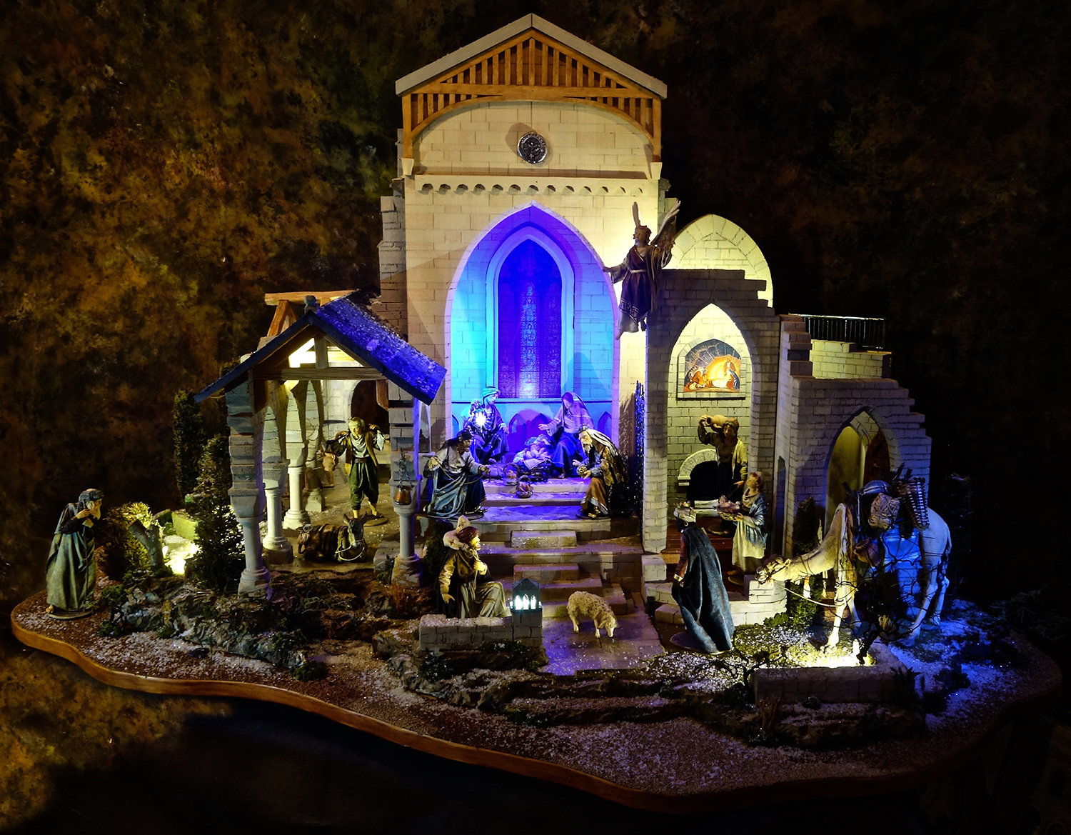 """Figure 22:The """"Christmas in the Castle"""" tour features a unique creation by  Navidad Nativities  of Bucks County, Pennsylvania. This custom Nativity setting was inspired by the art and architecture of Bryn Athyn Cathedral and Glencairn. The human and animal figures were hand carved in wood and dressed in starched fabric by Original Heide, a family business in the Italian Alps."""