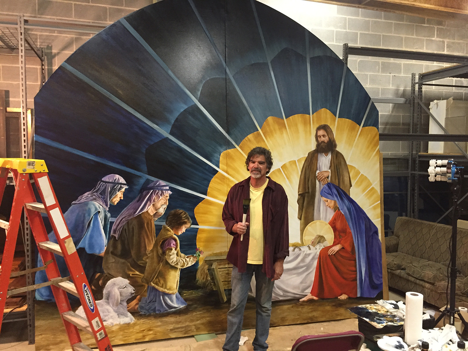 Bryn Athyn artist Edwin Herder with his nearly-completed, life-size painting of the Adoration of the Shepherds. The painting can be seen in Glencairn's Upper Hall throughout the holiday season.
