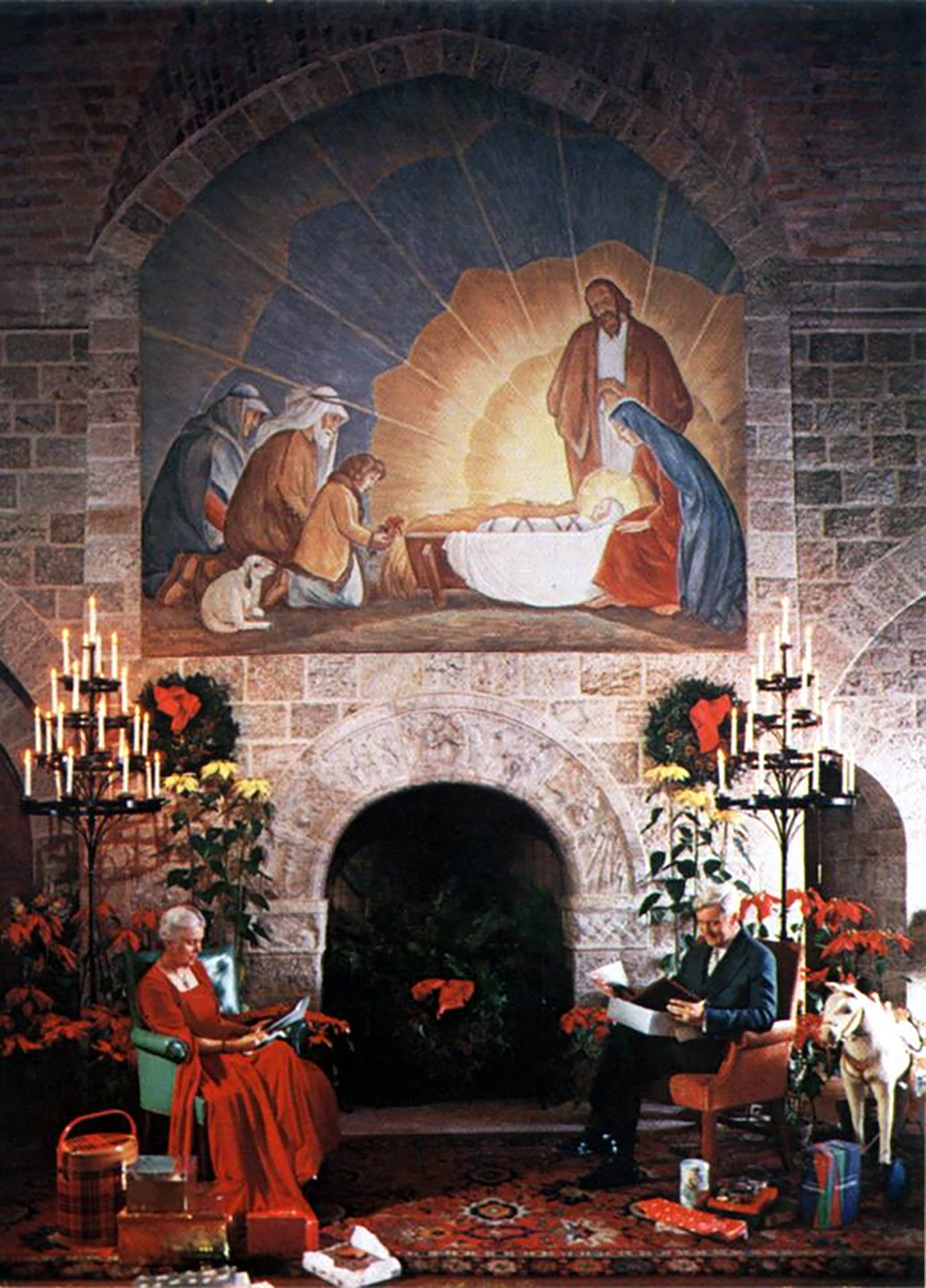 Figure 2: Raymond and Mildred Pitcairn pose for their 1954 Christmas card picture beside the Days of Creation fireplace in Glencairn's Upper Hall. Each year during the holiday season a large painting of shepherds visiting the baby Jesus was hung above the fireplace. The painting was adapted from an illustration in  The Christ Child , a children's book by Maud and Miska Petersham, who gave permission for this large-scale adaptation of their work.