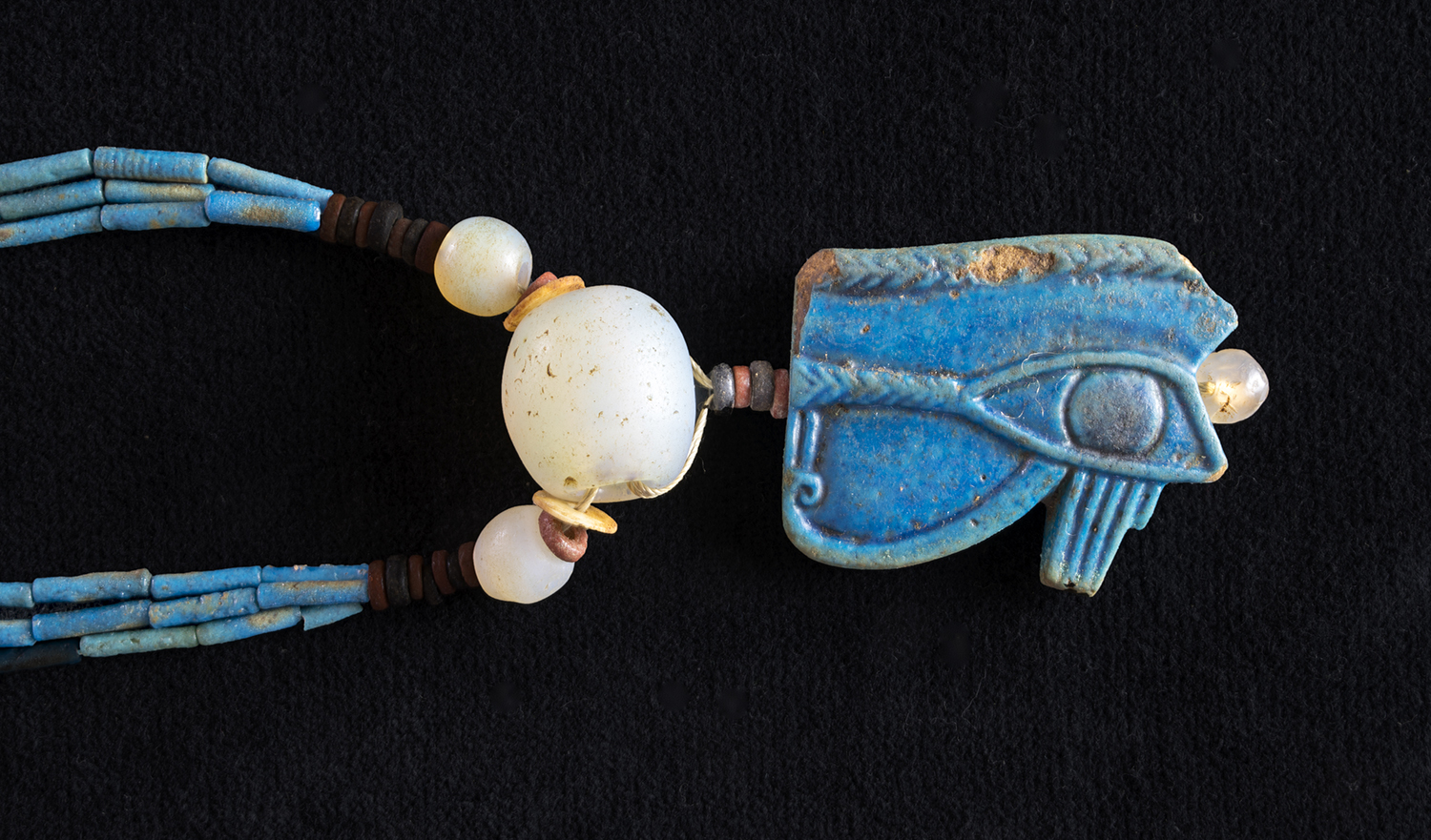 """Figure 33:   Wedjat  Eye . Perhaps the most popular of all Egyptian amulets, the  wedjat  eye, or the """"eye of Horus"""" amulet, represents the eye of that god, which had been damaged in a battle with his uncle, the god Seth (see also Figure 34). The injured eye was restored by means of magical powers and became whole and healthy again. The word  wedjat  means """"healthy"""" or """"sound,"""" and this amulet was worn as a wish for protection and health .  Glencairn Museum 15.JW.534."""