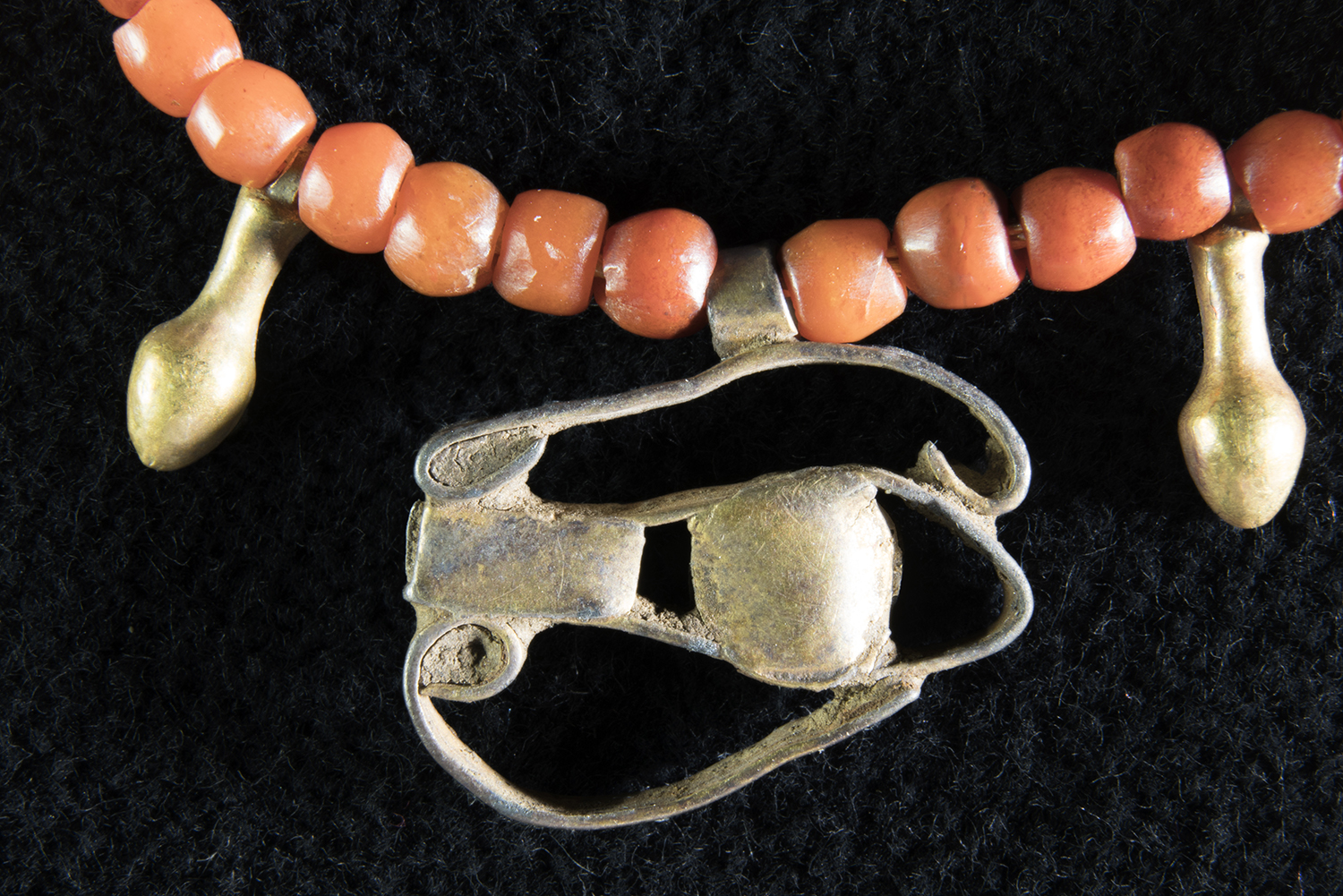 Figure 34:   Wedjat  Eye . There are quite a few examples of  wedjat  eye amulets and rings in the Glencairn collection, made of a variety of materials, several turquoise-colored faience amulets (see Figure 33), and this example, made of strips of gold. Glencairn Museum 15.JW.191.