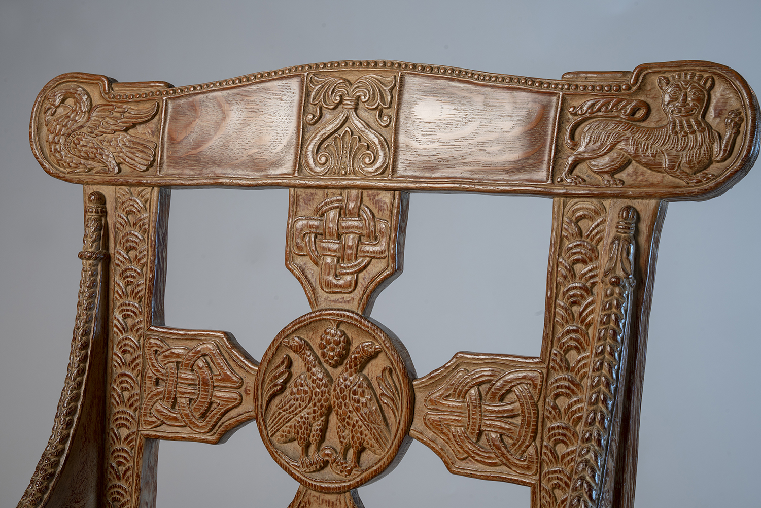 Figure 5: Glencairn's chair back (front side). Like the original Tyldal chair, a square cross is anchored by a central medallion. The upper arm of the cross has a design that was copied directly from the original Norwegian chair.
