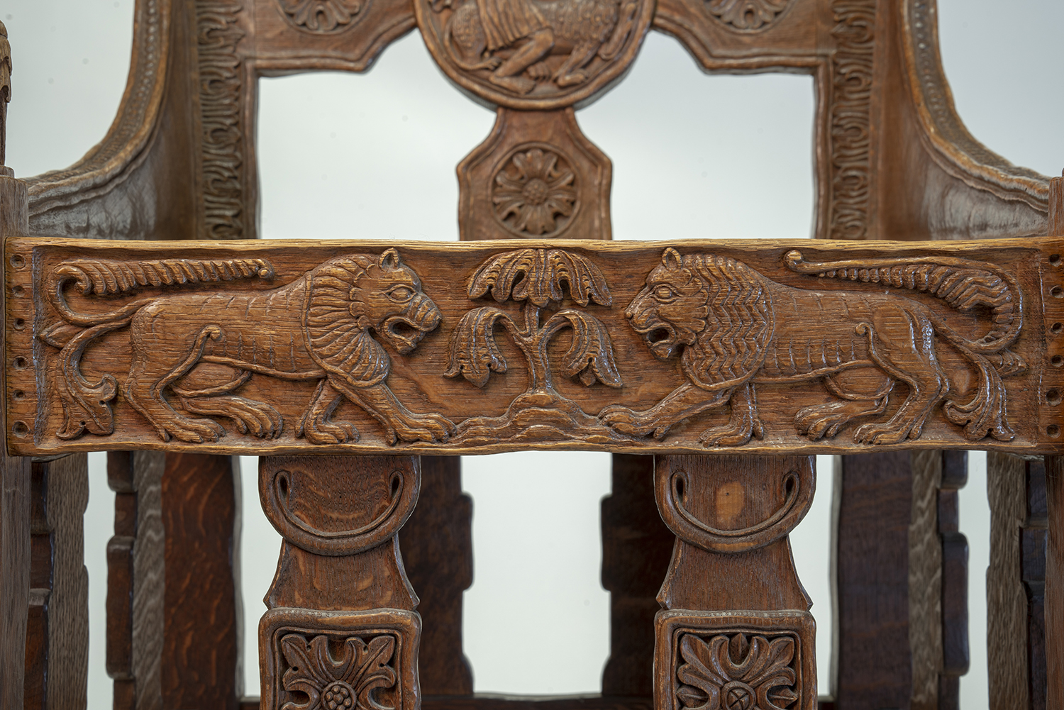Figure 16: Bryn Athyn Cathedral Tyldal-style chair with two lions facing each other on the chair apron. This chair also features a depiction of Samson slaying a lion (Judges 14:5)on the chair back (front side).