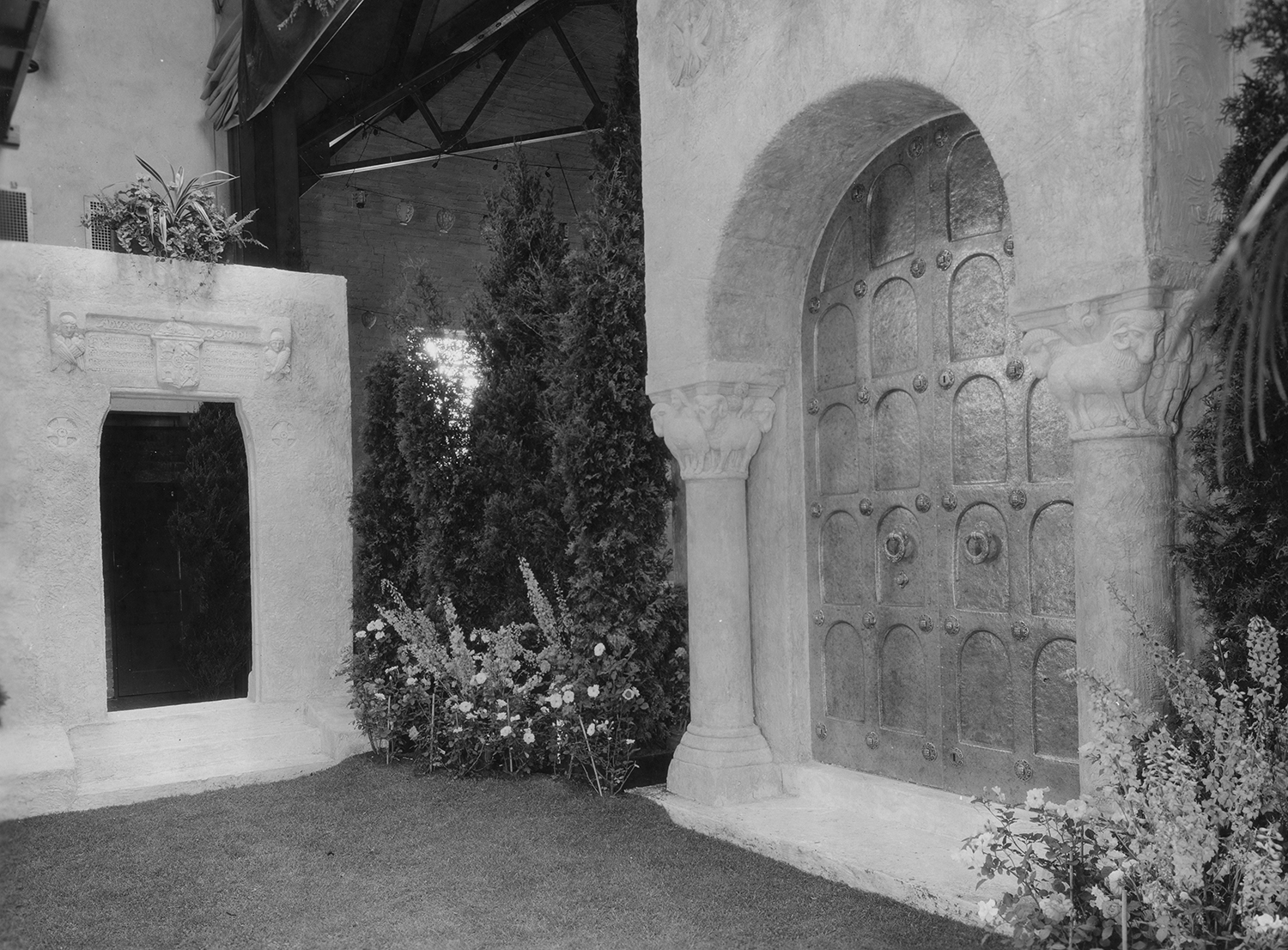 Figure 13: The left side of the Assembly Hall stage displayed a large plaster model of a doorway design concept for Glencairn's chapel.