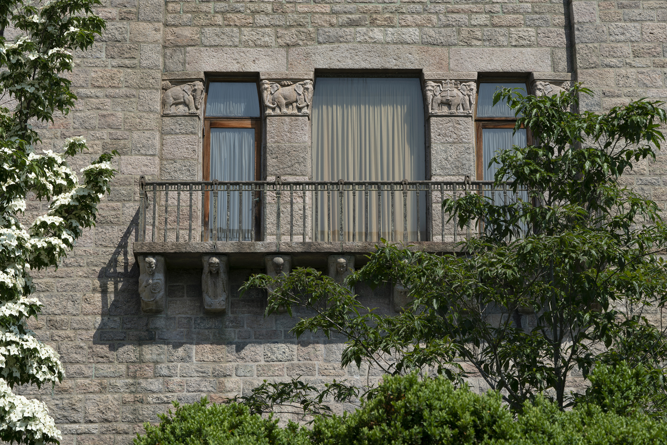 Figure 22: Today the Monel metal railing graces a third floor balcony on Glencairn's south side. The corbels supporting it depict the Pitcairn children holding various musical instruments.