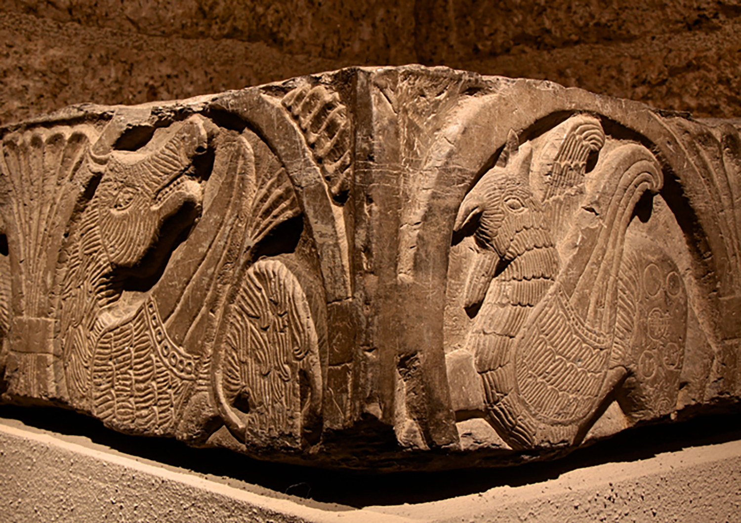 Figure 4: This fragment of a baptismal font, carved from a dark stone associated with the city of Tournai in Flanders, dates to the 12th century. Glencairn Museum 09.SP.1.