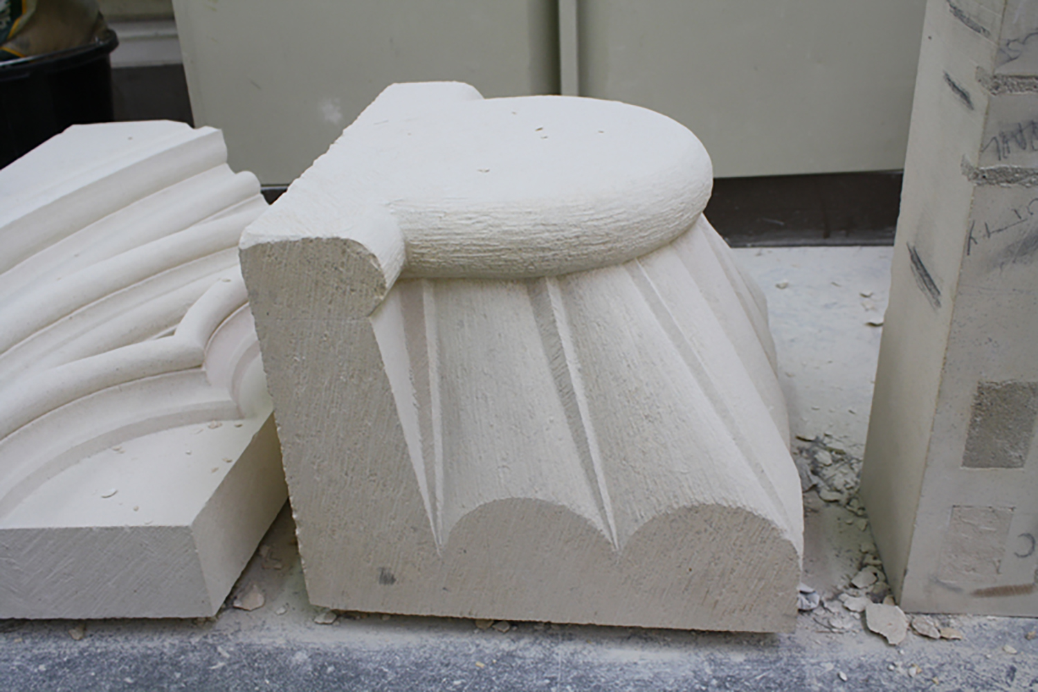 Figure 6: A modern carved capital in the masons' lodge at York Minster roughly finished with a claw chisel, photographed in the summer of 2014 by Julia Perratore.