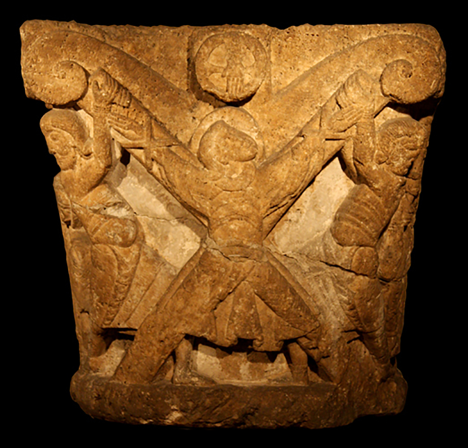 Figure 7: This limestone capital depicts the martyrdom of Andrew the Apostle, also known as Saint Andrew. Glencairn Museum 09.SP.3.