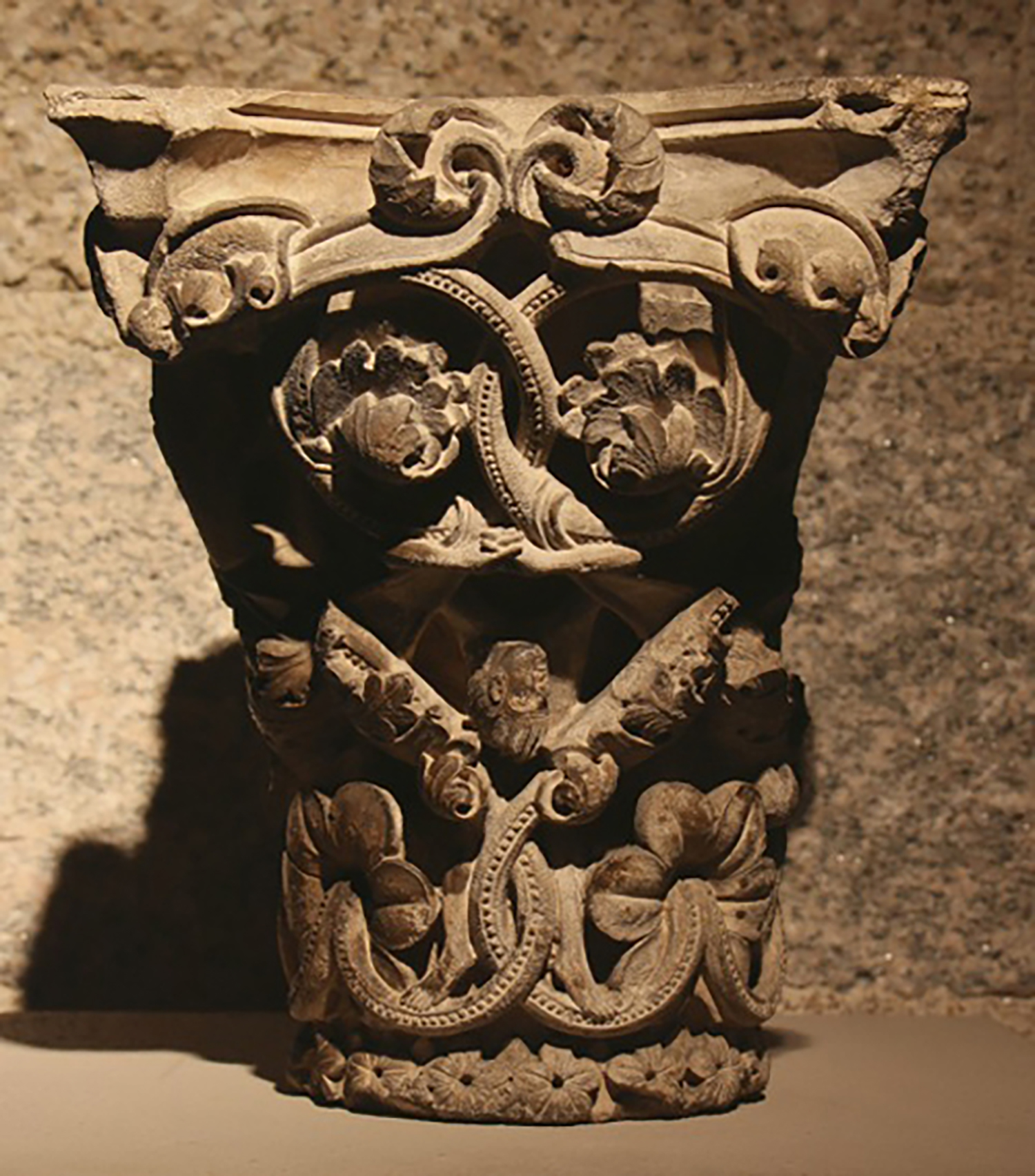 Figure 8: This limestone capital from Saint-Guilhem-le-Désert depicts a wide variety of figures, plant forms and ribbon patterns orchestrated in playful compositions. Glencairn Museum 09.SP.106.