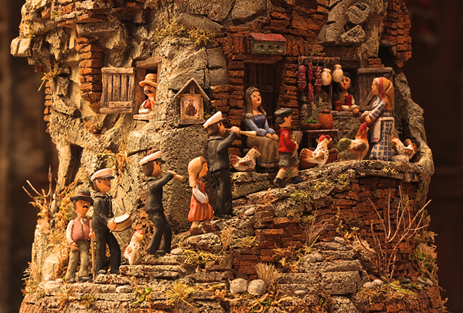 Figure 13: Detail view of Figure 12. R. Michael Palan, a professional artist from Westchester County, New York, created this Nativity in 2015 from cork, wood, polymer clay and acrylic paint. On loan from R. Michael Palan.