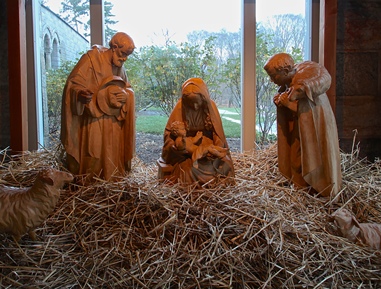 Figure 15: Nativities have been carved in the small Bavarian village of Oberammergau for many generations, and today approximately 200 woodcarvers work in the village. At one time Ludwig Kraus, who carved this large Nativity from basswood, had 45 woodcarvers working for him in his studio. This Nativity, which Kraus carved between 1958 and 1965, was in the window of Marshall Field's flagship store in Chicago at Christmastime. Kraus died in 1982, but the woodcarving shop continues under his nephew, Ernst Kraus, who apprenticed with his uncle. On loan from the National Christmas Center and Museum.