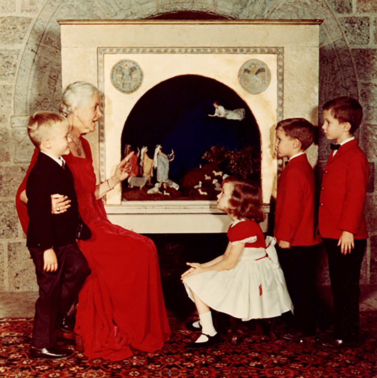 Figure 2: Mildred Pitcairn at Glencairn with her grandchildren in 1967, in front of the Nativity made for the Pitcairn family in the 1920s by Winfred S. Hyatt.