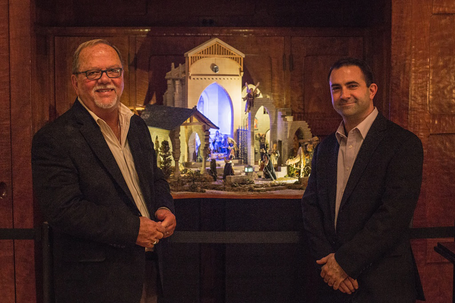 Figure 9: Michael Stumpf (left) and A.J. DiAntonio pose with  The Glencairn Nativity  at an exhibition preview on November 23, 2015. Photo: Kyle Genzlinger.