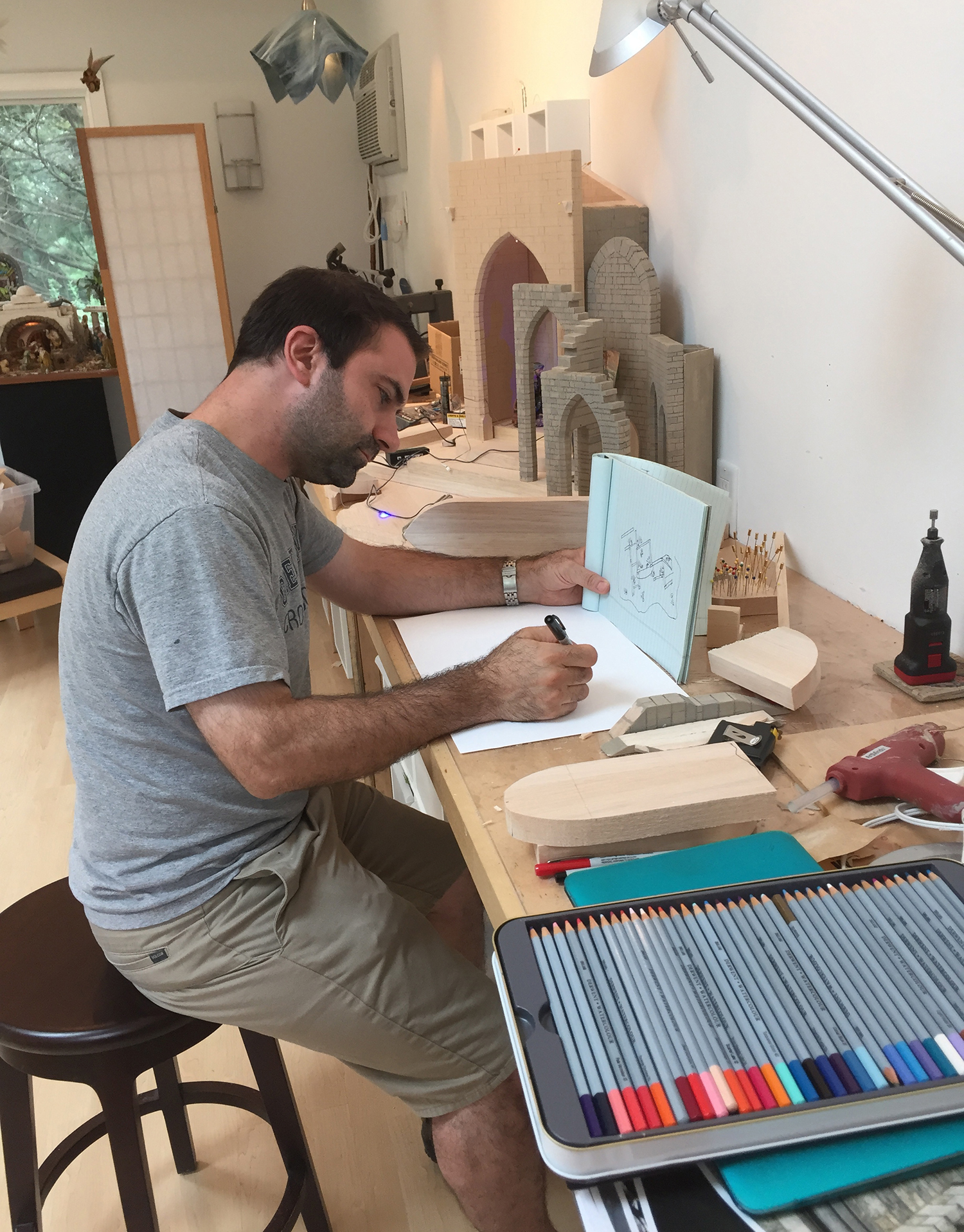 Figure 10: A.J. DiAntonio has been building Nativity scenes since he was about five years old. In this photo he is working on the design for  The Glencairn Nativity  in the Bucks County atelier of Navidad Nativities.