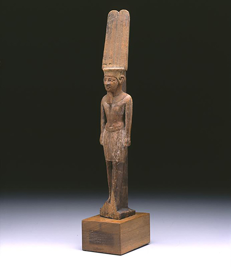 Figure 2: A wooden statue of the god Amun, Third Intermediate Period (1075-656 BCE). Penn Museum E14325.