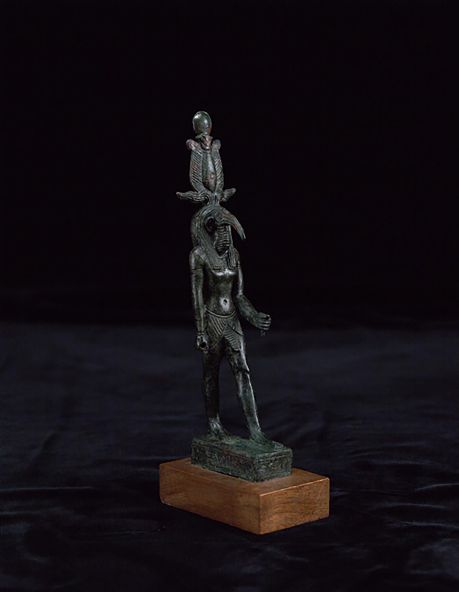 Figure 3: A bronze votive statuette of the god Thoth, Ptolemaic Period (305-30 BCE). Penn Museum E14298.