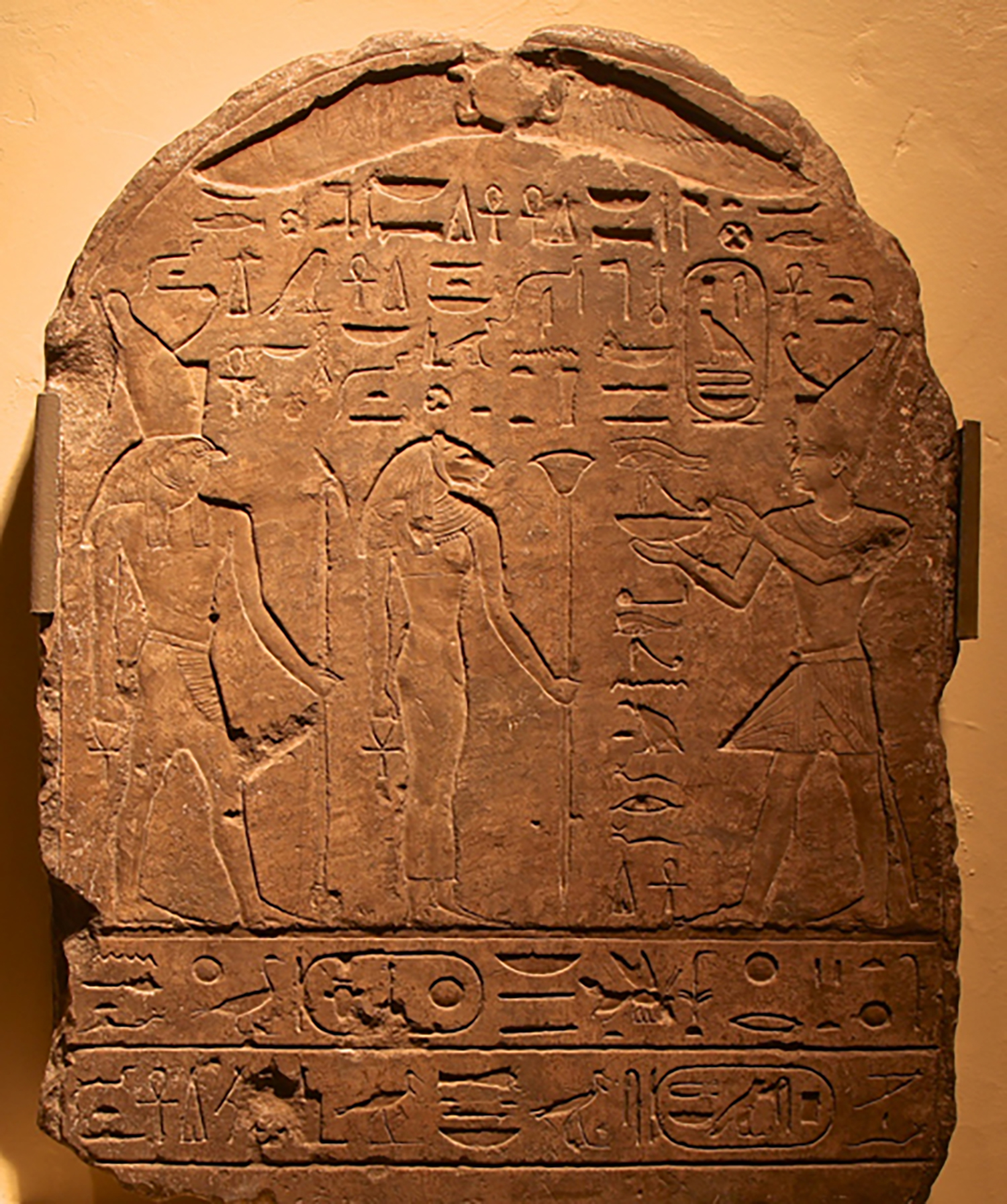 Figure 9: A stela dated to the reign of King Psammetichus II showing the king offering before Bastet and her son. Glencairn Museum E1152.