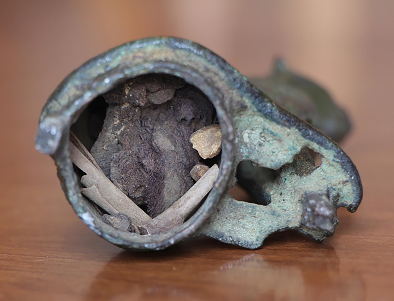 Figure 18: The interior of Glencairn's bronze cat votive contains feline bones, perhaps from a mummified cat. Glencairn Museum E60.
