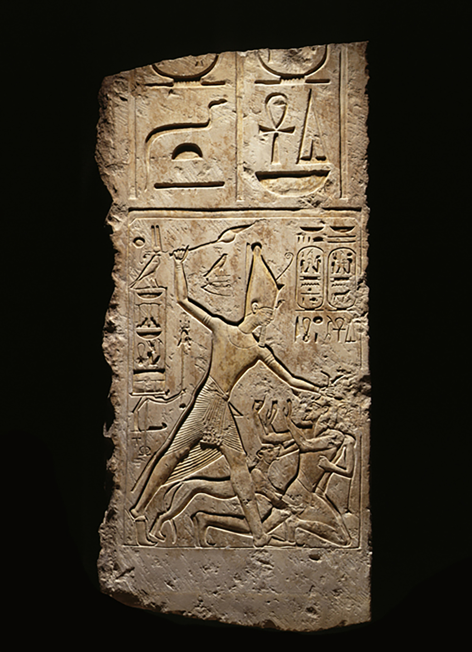 Figure 22: Limestone relief depicting Merneptah attacking enemies accompanied by a lioness, from the palace of Merenptah at Memphis, Dynasty 19 (1213-1204 BCE). Penn Museum E17527.