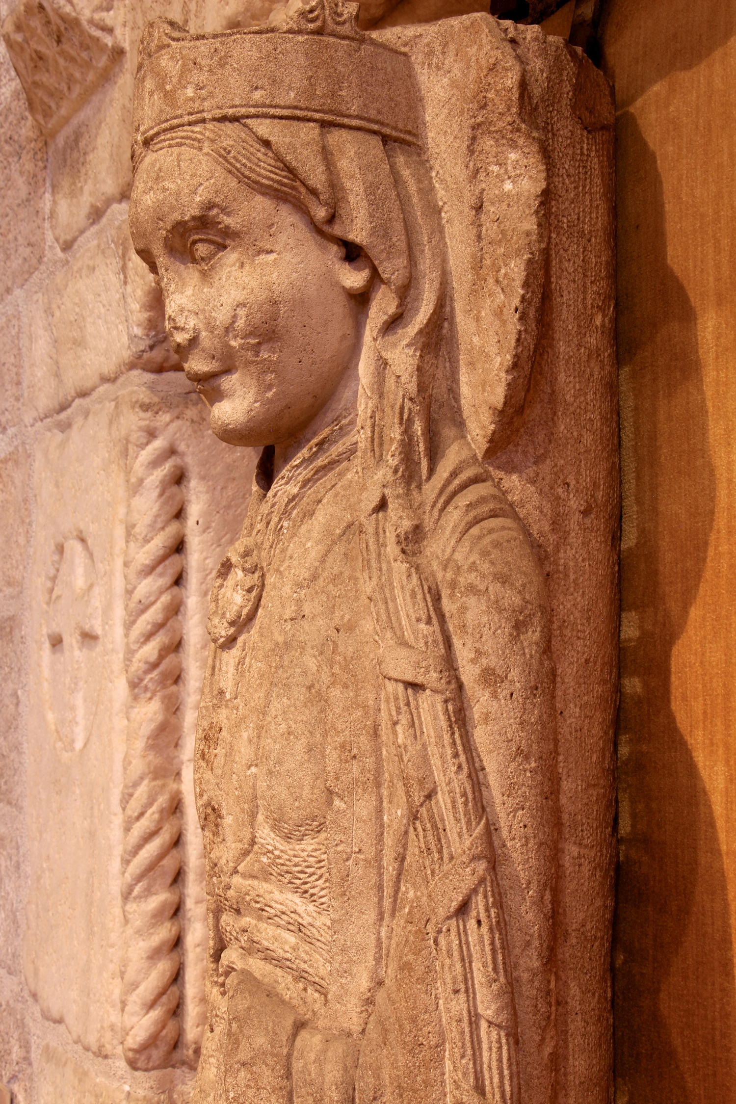 Figure 3: The back of the figure is attached to a round column. Her long hair is bound into braids.