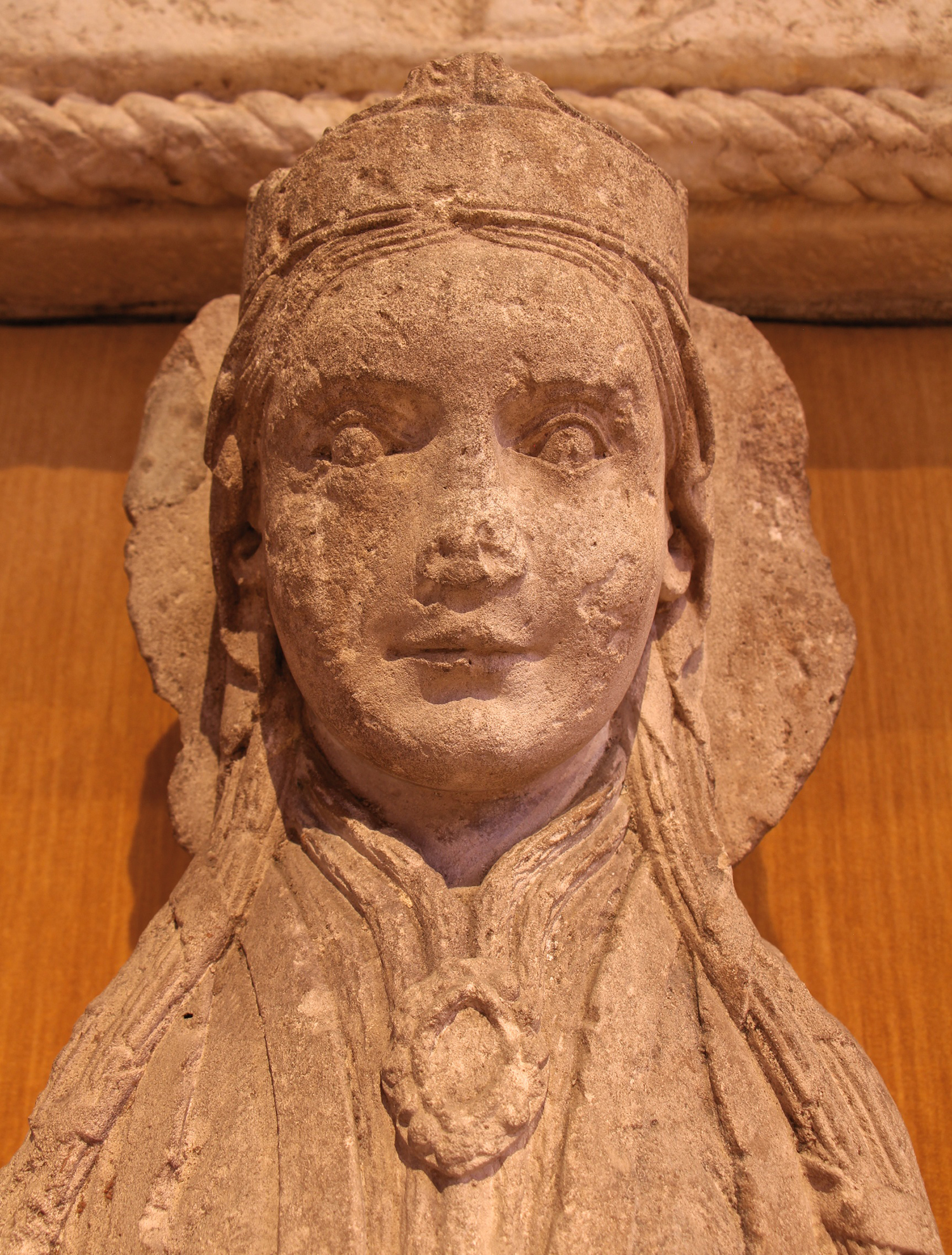 Figure 5: The head of the statue is topped with a crown, worn over a simple veil. The large halo indicates that she was a holy person.
