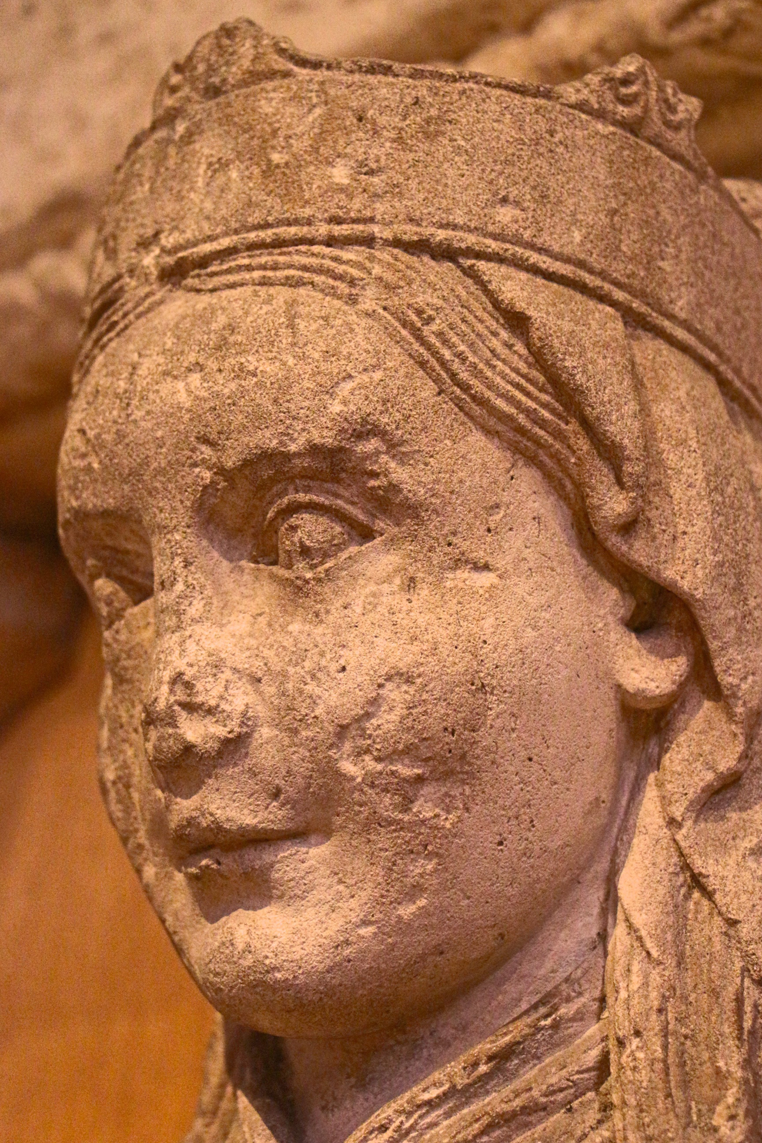 Figure 6: The sculpture's lips are set in a relaxed, mirthful manner, regarding onlookers with a pleased expression.