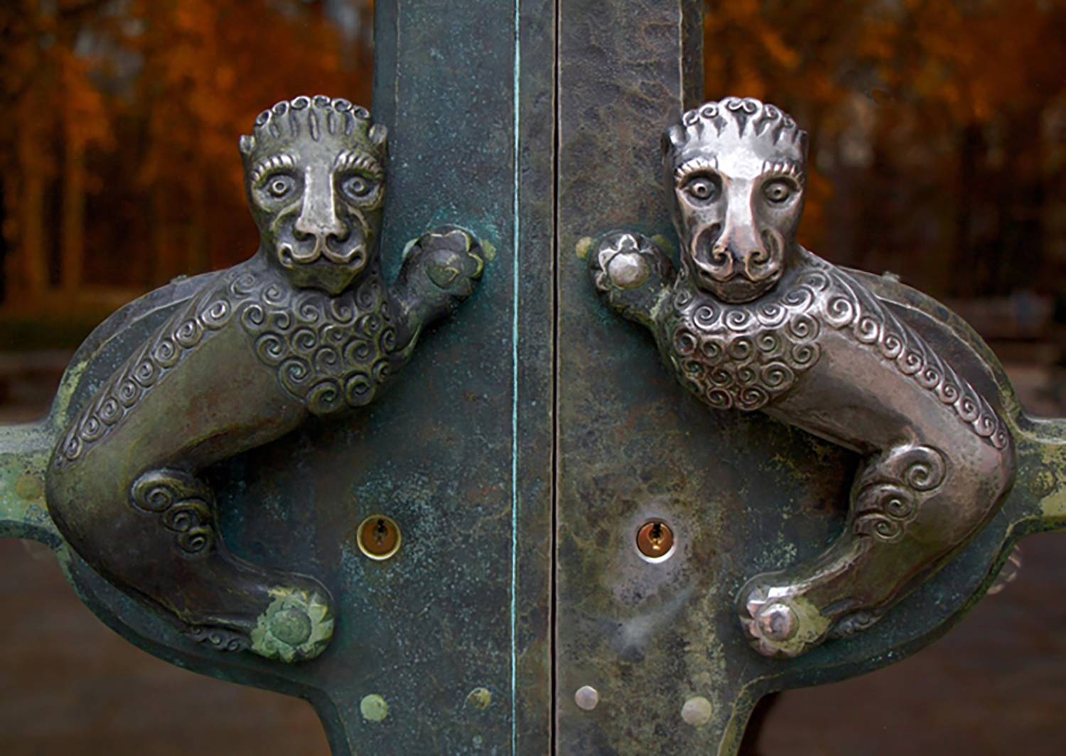 Figure 9: The door handles for the everyday entrance to Glencairn are lionesque-style creatures made from Monel. The right-hand one has a different patination because it is the side that opens and is therefore touched more frequently.
