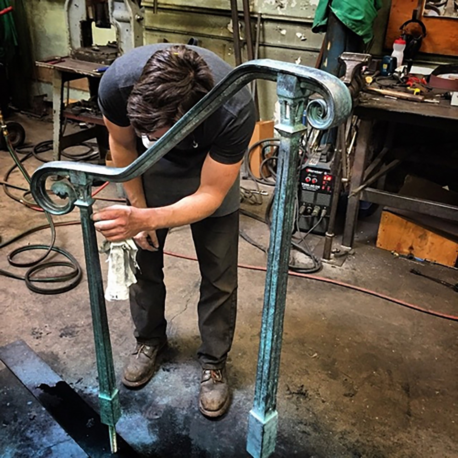 Figure 18: Warren Holzman doing final work on a new railing for Glencairn in the Iron Studio shop. Two railings were made from stainless steel, finished to resemble Monel, for Glencairn's front steps. Photograph courtesy of Warren Holzman.