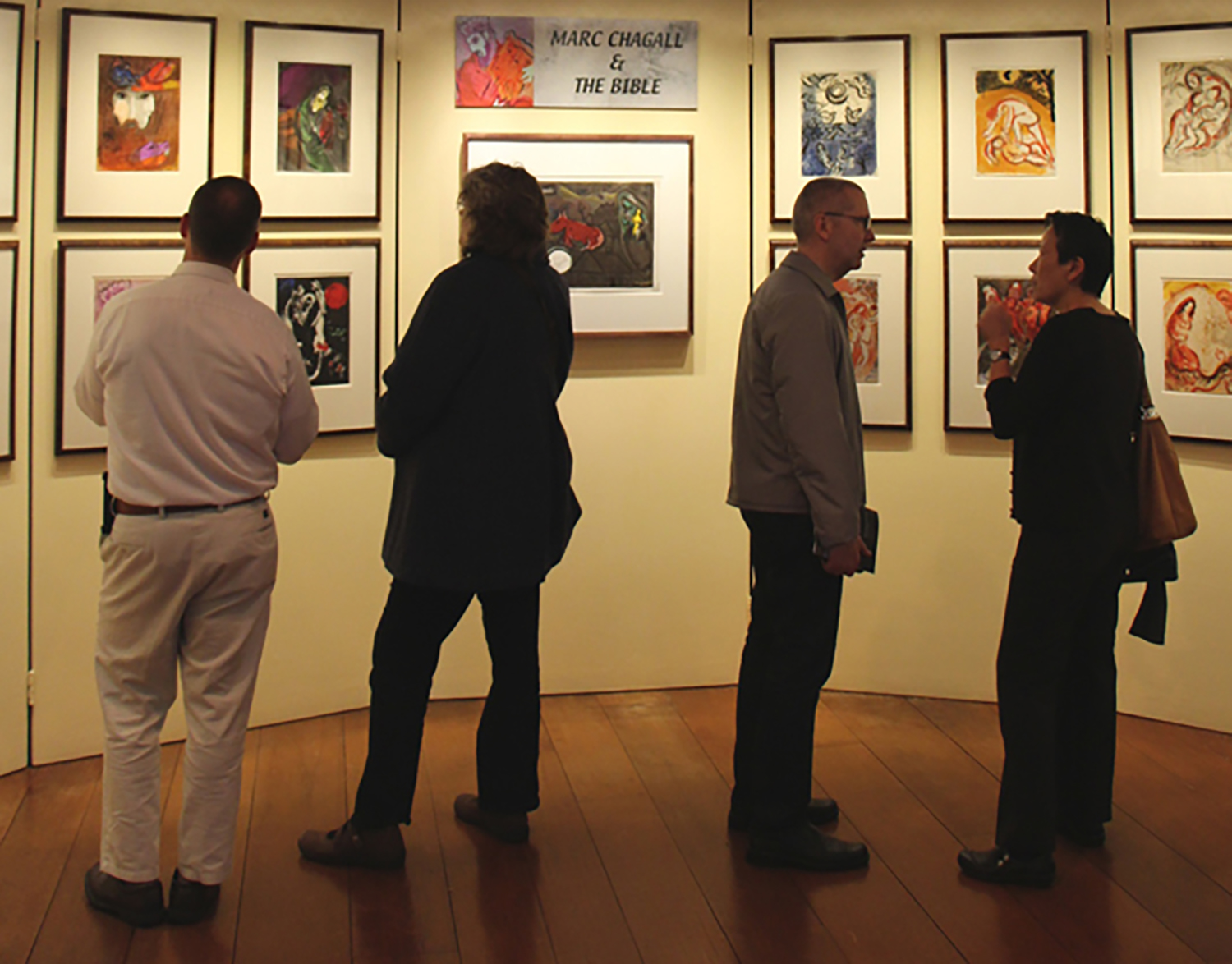 Viewers enjoying the exhibition  Marc Chagall and the Bible .