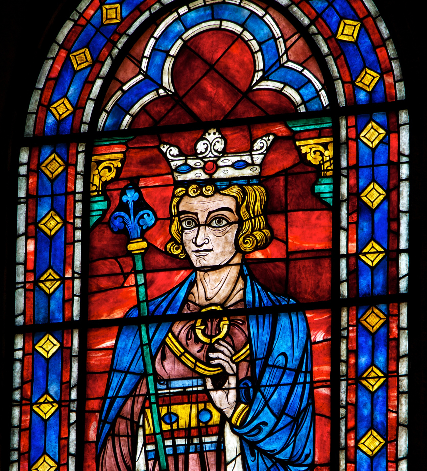 Figure 6: This early 20th-century reproduction of a stained glass window in Chartres Cathedral depicts King Solomon. It was made in the Bryn Athyn glassworks in the 1930s for the north wall of Glencairn's Great Hall.