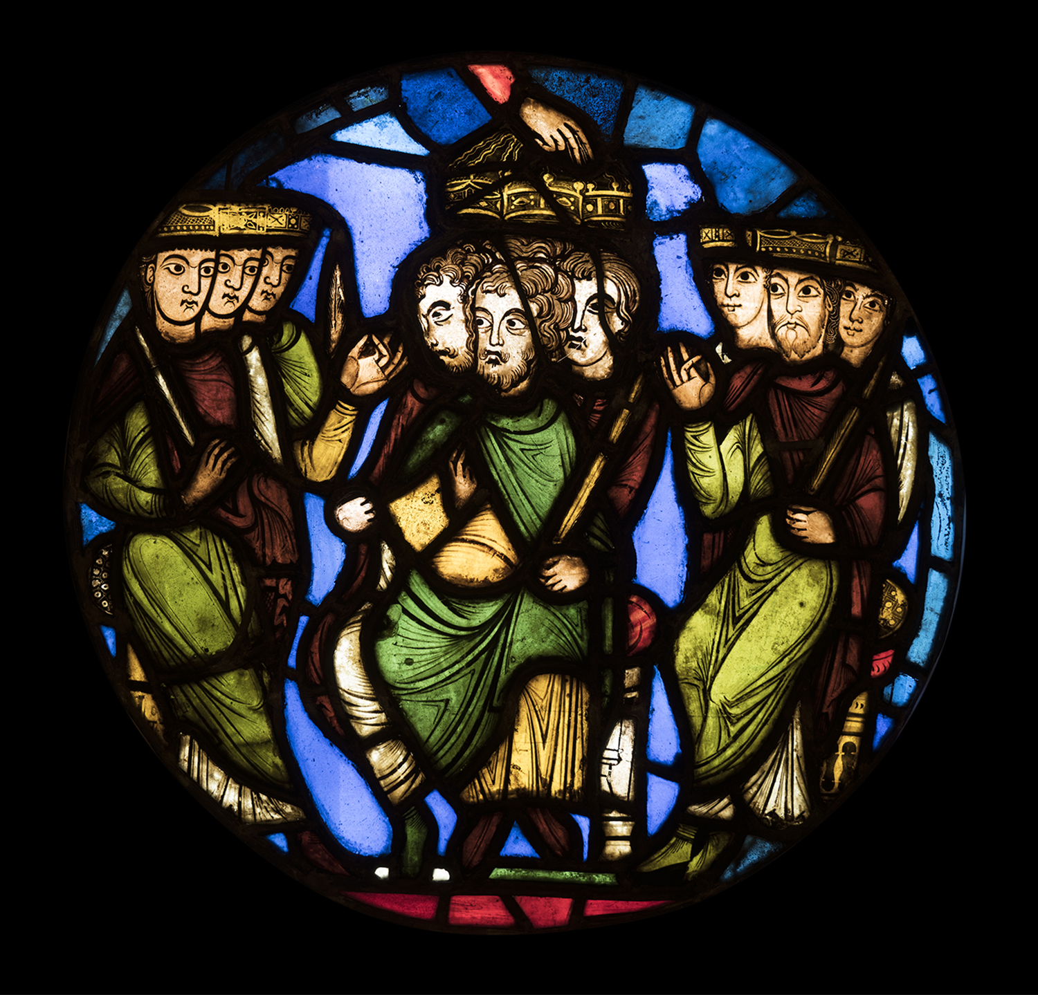 Figure 9:A Coronation Scene, stained-glass panel from the Royal Abbey Church of Saint-Denis, outside Paris, France, c. 1150. The Hand of God in the center crowns three kings (03.SG.111).