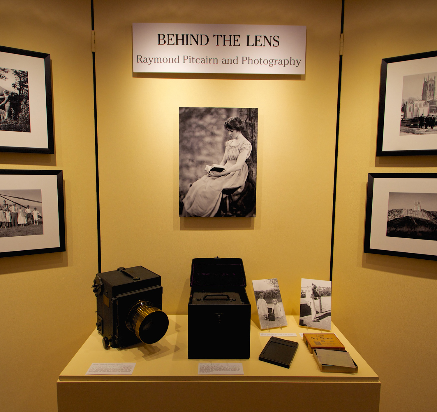 Central exhibition panel for  Behind the Lens: Raymond Pitcairn and Photography .
