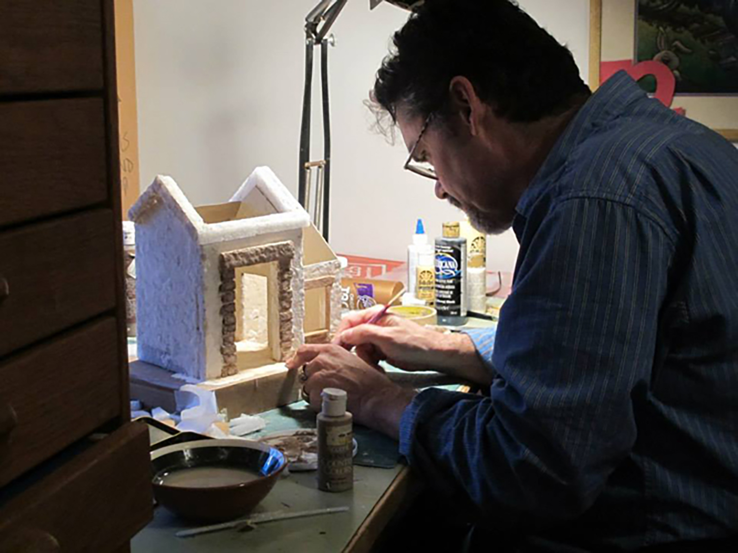 Figure 3: R. Michael Palan working on one of the structures for the Presepio.
