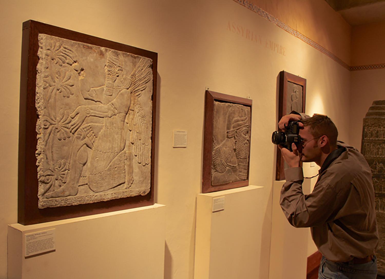 Philipp Serba photographing Glencairn's Assyrian reliefs.