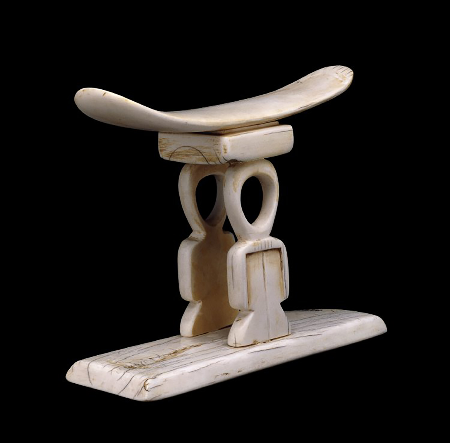 Figure 14:Ivory headrest with support carved in the shape of the  tyet , or Isis knot, from the British Museum (EA30727). Image courtesy of The British Museum.