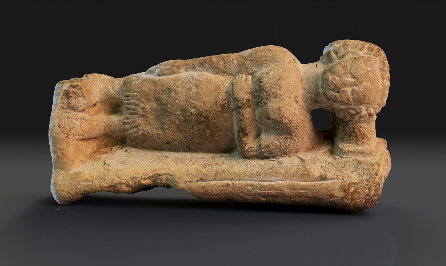 Limestone figure of a sleeping woman using a headrest in the collection of Glencairn Museum (E1219).