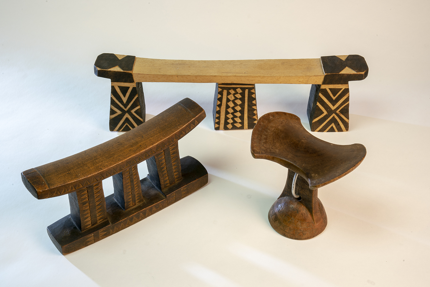 Figure 2:Several 20th-century African headrests in the collection of Glencairn Museum.